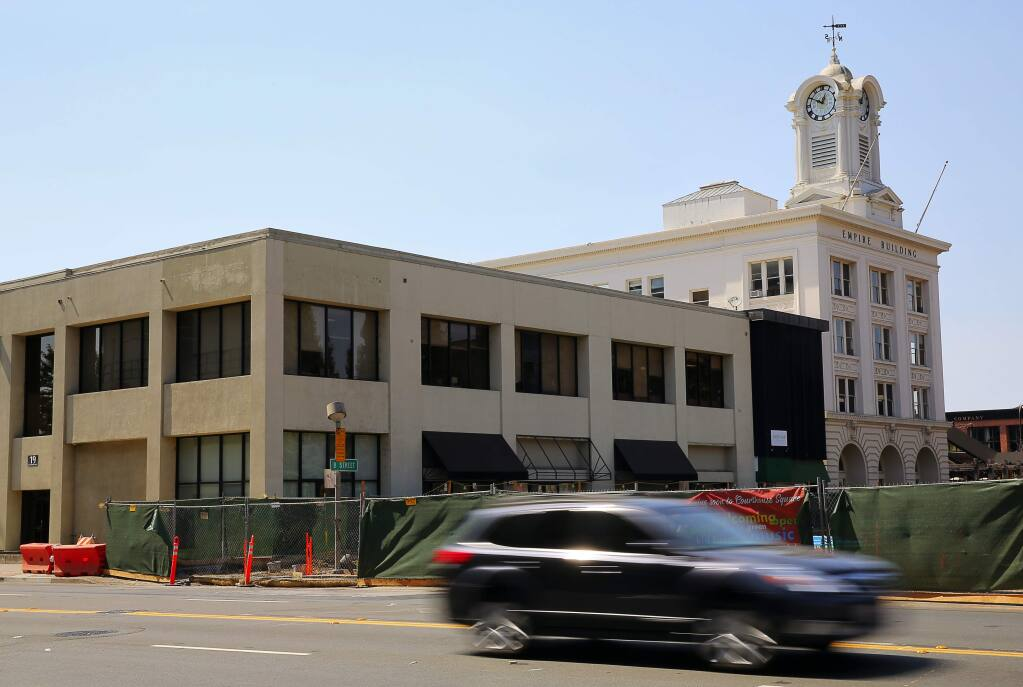 19 Old Courthouse Square, left, shown in a 2016 file photo, will be demolished this month to make way for a new building that will become part of the Hotel E development project. The new building will house hotel rooms, a Perry's restaurant and a Starbucks, and a rooftop cafe and bar. (Christopher Chung/ The Press Democrat)