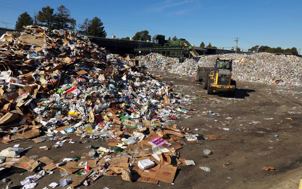 Piles of recyclable material fill the North Bay Corporation's recycling facility on Standish Avenue in Santa Rosa on Monday, Jan. 30, 2017. (John Burgess/The Press Democrat)