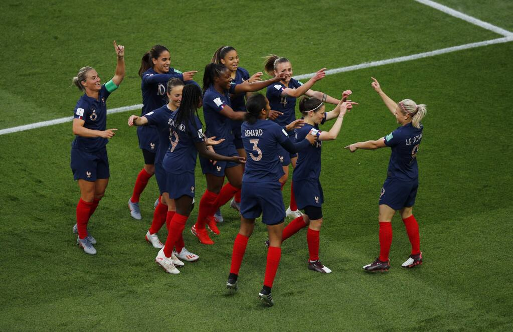 France's Eugenie Le Sommer, right, celebrates with her teammates after scoring her side's opening goal during the Women's World Cup Group A soccer match between France and South Korea, at the Parc des Princes in Paris, Friday, June 7, 2019. (AP Photo/Francois Mori)