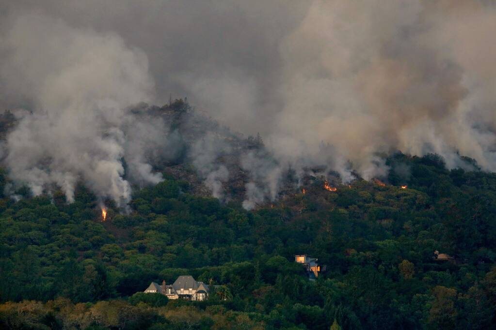 Flames from the Southern Complex fire creep downhill toward homes overlooking Kenwood Vineyards, in Kenwood, California, on Tuesday, October 10, 2017. (Alvin Jornada / The Press Democrat)