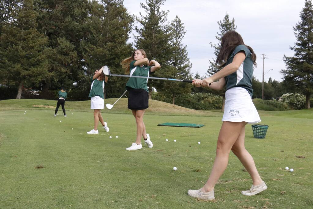 Members of the Sonoma Valley girls golf team - including Samantha Pencil, center - practice their drives at Sonoma Golf Club prior to their match with Napa. (Christian Kallen/Index-Tribune)