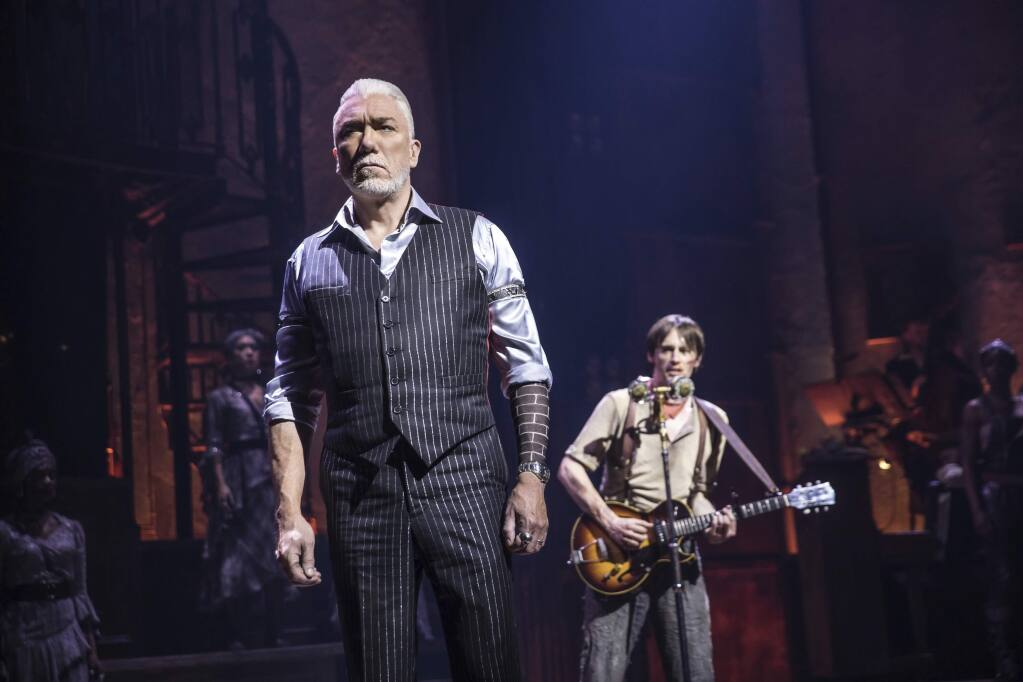 This image released by DKC O&M Co. shows Patrick Page, left, and Reeve Carney during a performance of 'Hadestown,' directed by Rachel Chavkin. (Matthew Murphy/DKC O&M Co. via AP)
