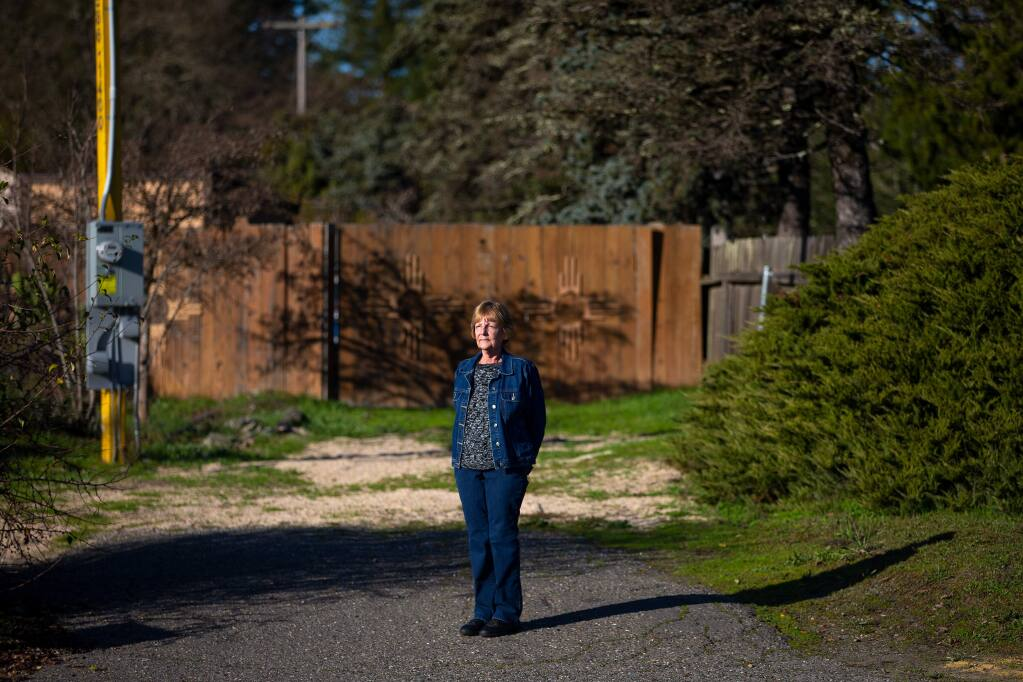 Charlene Flowers, a resident of Blue Spruce Lodge senior community, stands in the driveway where the Graton Community Services District has proposed to install a sewage receiving station that will be next door to Flowers' neighborhood in Sebastopol, California, on Wednesday, January 22, 2020. (Alvin Jornada / The Press Democrat)