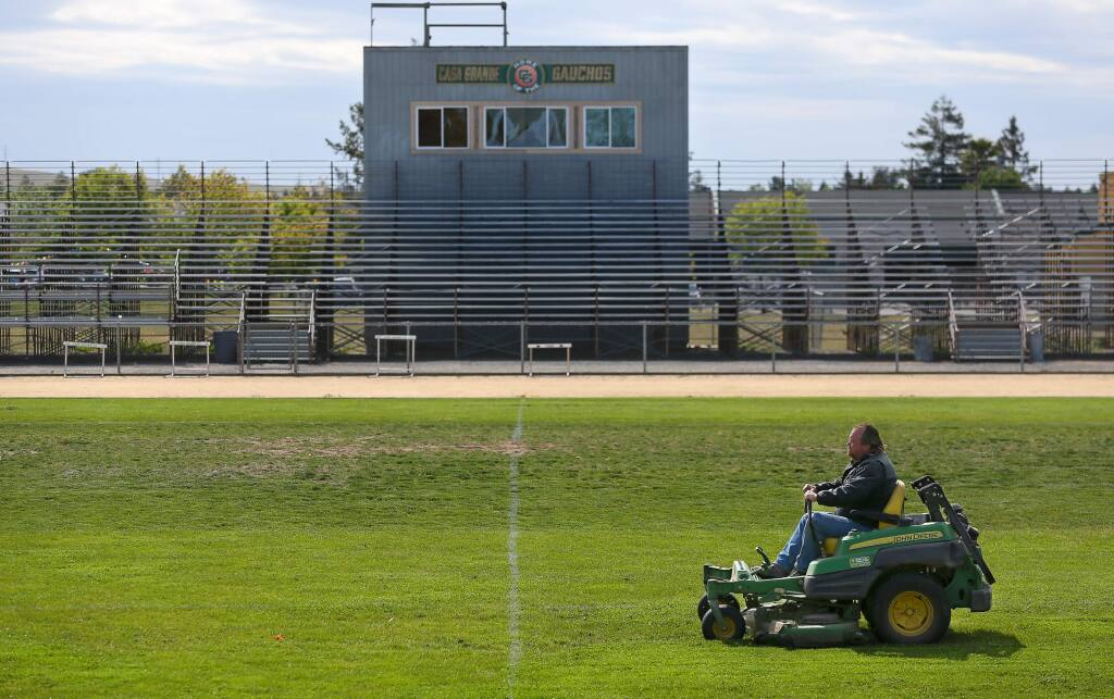 Jim Whitt mows the grass on the football field at Casa Grande High School, in Petaluma on Thursday, May 7, 2015. The irrigation at the school is controlled and monitored using technology by HydroPoint Data Sytems to save water. (Christopher Chung/ The Press Democrat)