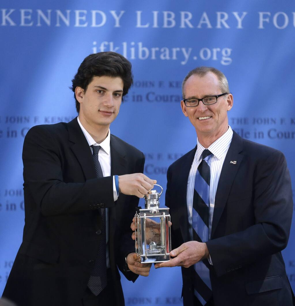Jack Schlossberg, left, grandson of for President John F. Kennedy, presents former U.S Rep. Bob Inglis, R-S.C., right, with the 2015 Profile in Courage Award, at the John F. Kennedy Library and Museum, Sunday, May 3, 2015, in Boston. Inglis was awarded the prize for reversing his position on climate change. (AP Photo/Steven Senne)