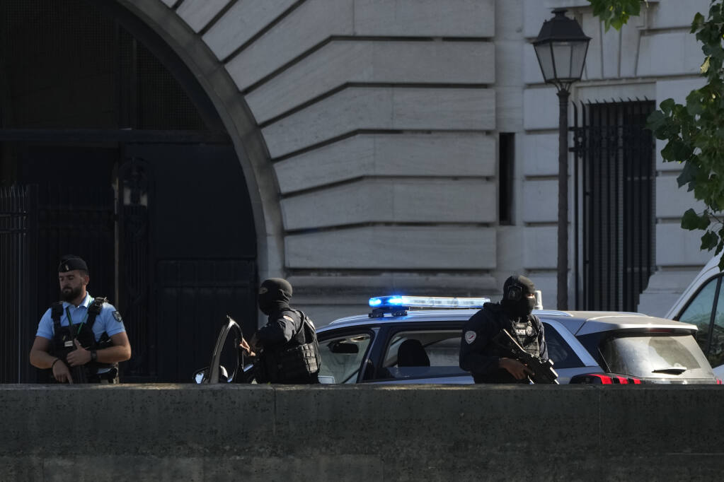 Security forces guard an entrance of the Palace of Justice Wednesday, Sept. 8, 2021 in Paris. (AP Photo/Francois Mori)