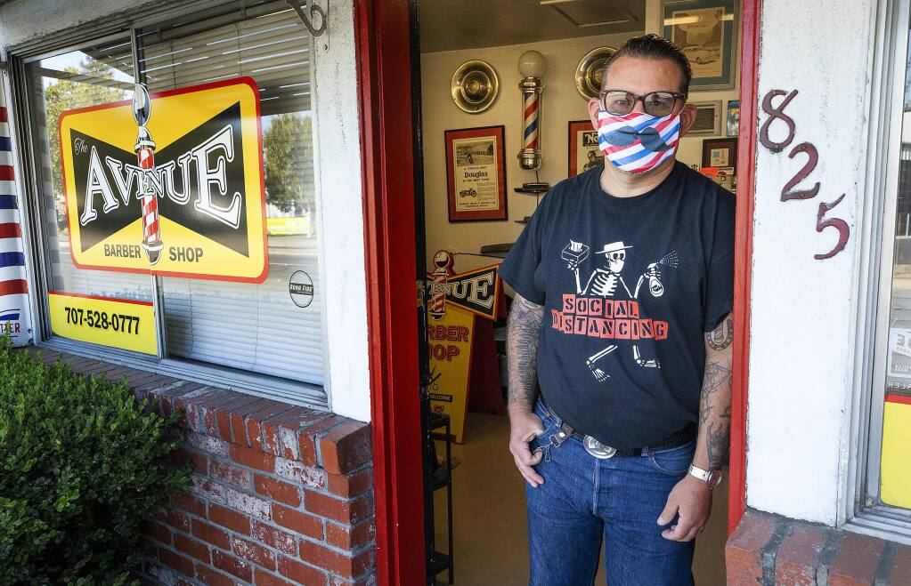 Brien Jones once again closed his Avenue Barber Shop in Santa Rosa on Tuesday, July 14, 2020, in light of the state's renewed restrictions on salons, barbers and other industries. (John Burgess / The Press Democrat)
