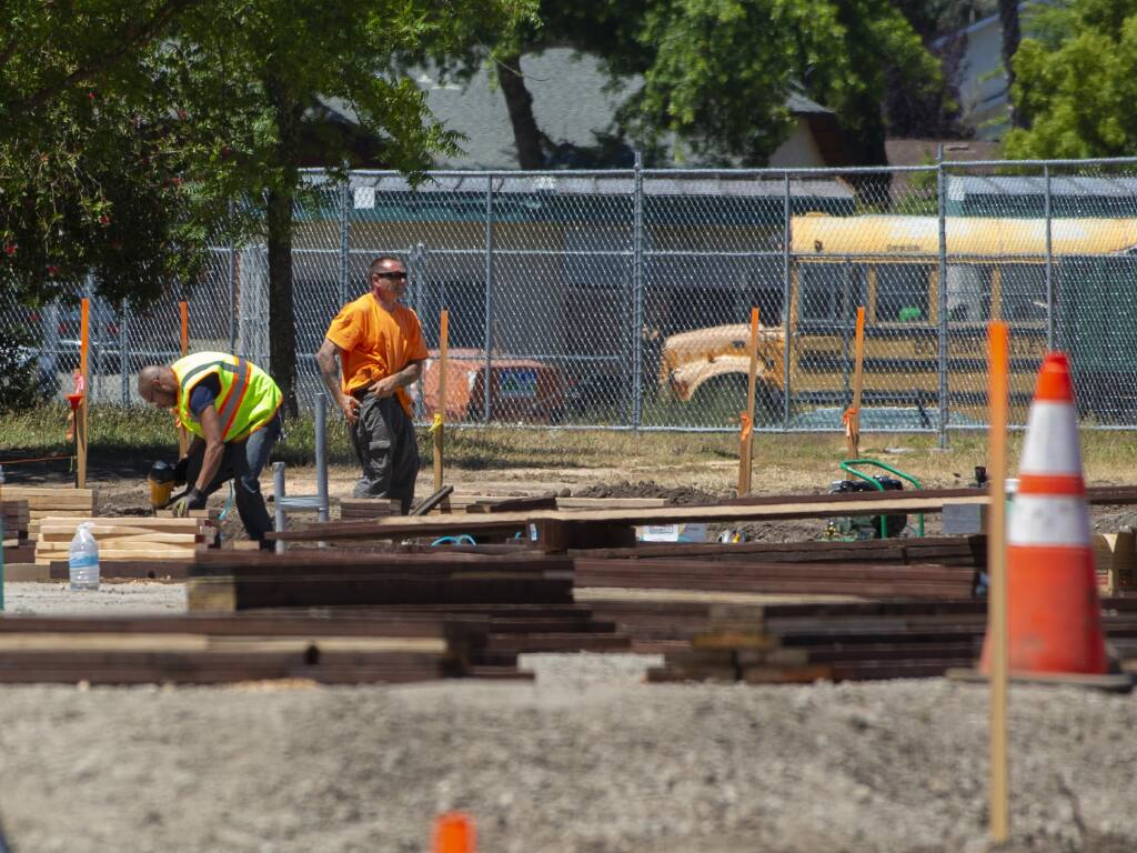 At issue is whether Sonoma Valley Unified will only contract with businesses that employ union construction workers going forward. Construction projects with heavy machinery vies for space next to playground equipment at El Verano Elementary School in Boyes Hot Springs in 2019. (Photo by Robbi Pengelly/Index-Tribune)