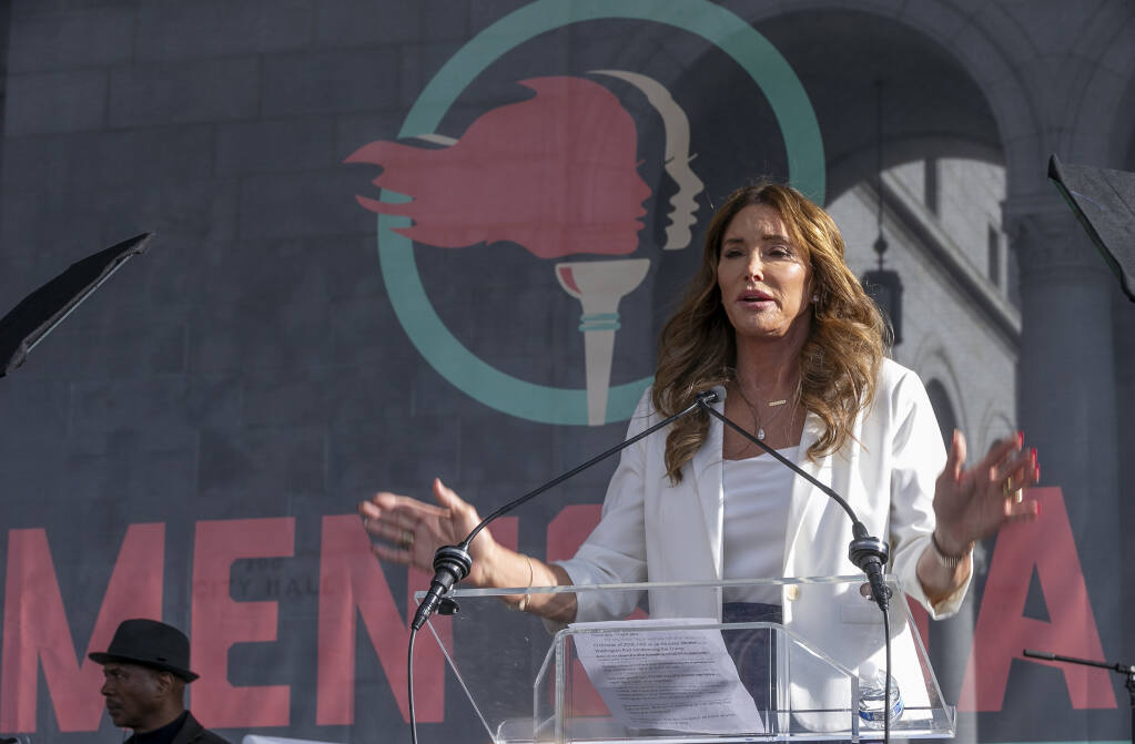 "FILE - In this Jan. 18, 2020, file photo, Caitlyn Jenner speaks at the fourth Women's March in Los Angeles. Jenner, the former Olympic champion and reality TV personality now running for California governor, said she opposes transgender girls competing in girls' sports at school. Jenner told a TMZ reporter on Saturday, May 1, 2021, that it's ""a question of fairness."" (AP Photo/Damian Dovarganes, File)"