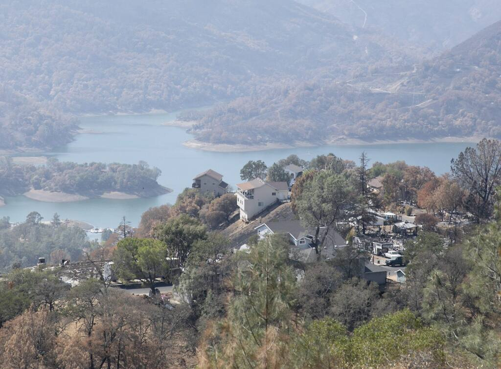 Homes destroyed by the LNU Lighting Complex Fire are interspersed with untouched homes above Lake Berryessa, a resort area and water supply reservoir, on Sept. 21, 2020. After the fire in August, residents were advised not to drink or boil the tap water because of concerns about benzene and other contaminants. (Photo by Anne Wernikoff for CalMatters)