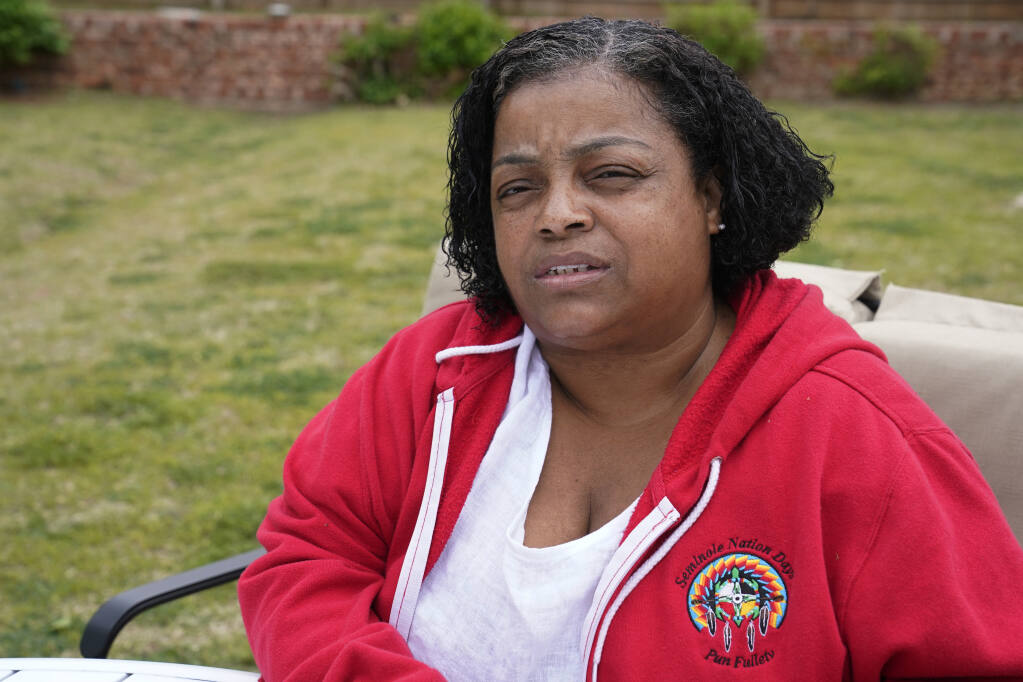 LeEtta Osborne-Sampson is pictured outside her home Monday, April 26, 2021, in Oklahoma City. Sampson-Osborn, a Seminole Freedman who has a tribal identification card and serves on the tribe's governing council, said when she went to the Indian Health Services clinic to get a vaccination in February, a worker at the clinic told her the Seminole Nation doesn't recognize Freedmen for health services. (AP Photo/Sue Ogrocki)