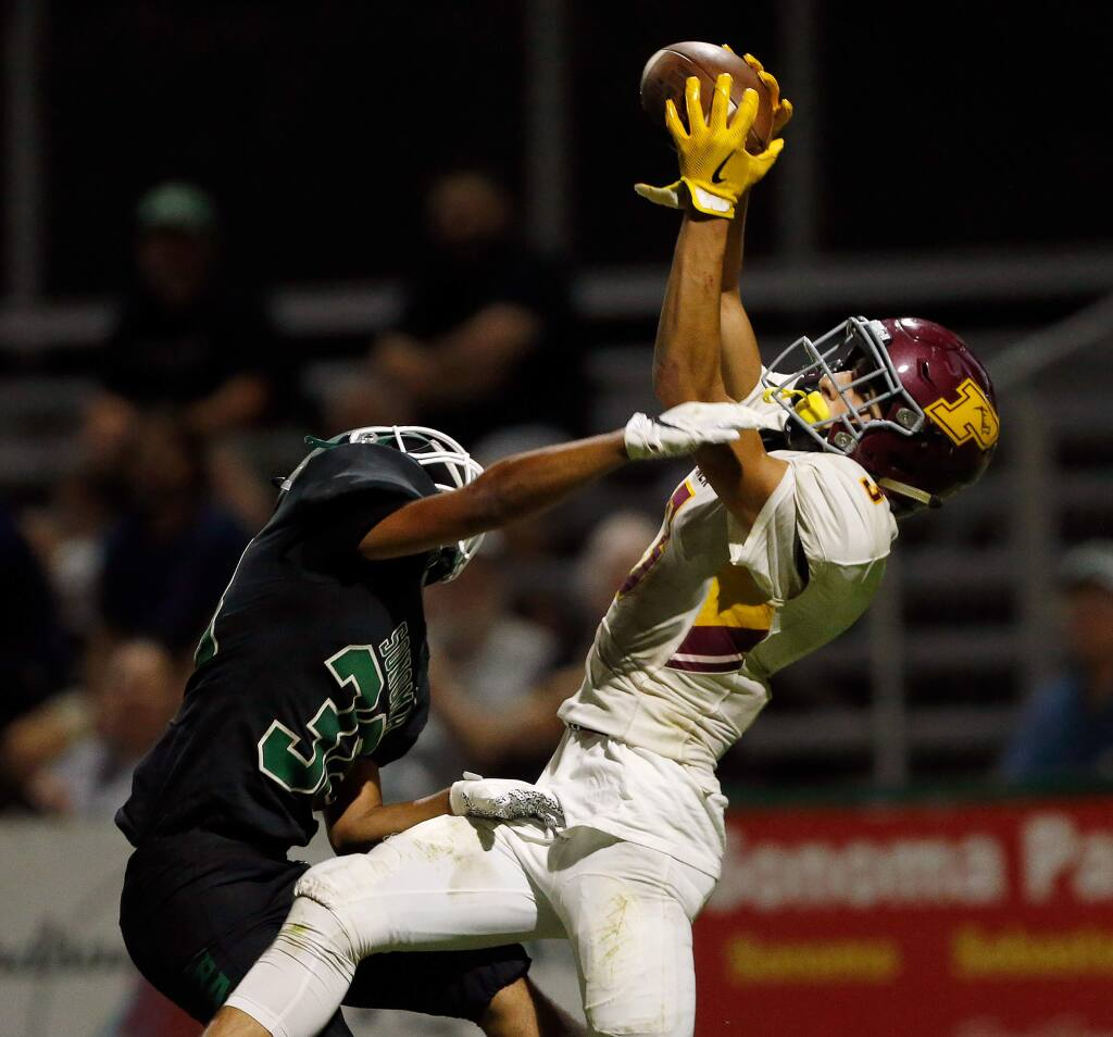 Piner's Isaac Torres, right, pulls down a touchdown catch while guarded by Sonoma Valley's Adair Gallardo during the first half in Sonoma on Friday, Sept. 13, 2019. (Alvin Jornada / The Press Democrat)