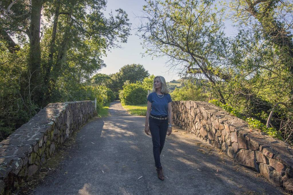 Anna Pope, the trustee of the Frank H. Bartholomew Foundation, walks along one of the trails that are now open to hikers at the Sonoma winery and museum estate. (Photo by Robbi Pengelly/Index-Tribune)