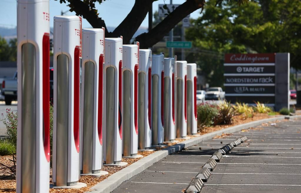 Tesla electric vehicle charging stations have been installed at along the north end of the Coddingtown Mall parking lot, near Guerneville Road, in Santa Rosa.(Christopher Chung/ The Press Democrat)