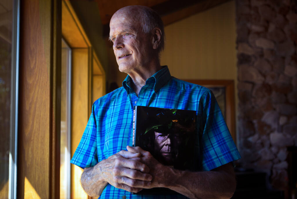 Robert Lyon at Lyon Ranch in Sonoma, with a copy of 'Vietnam War Portraits: The Faces and Voices.' As a U.S. Navy pilot, Lyon flew more than 100 missions over North Vietnam. (Photo by Robbi Pengelly/Index-Tribune)