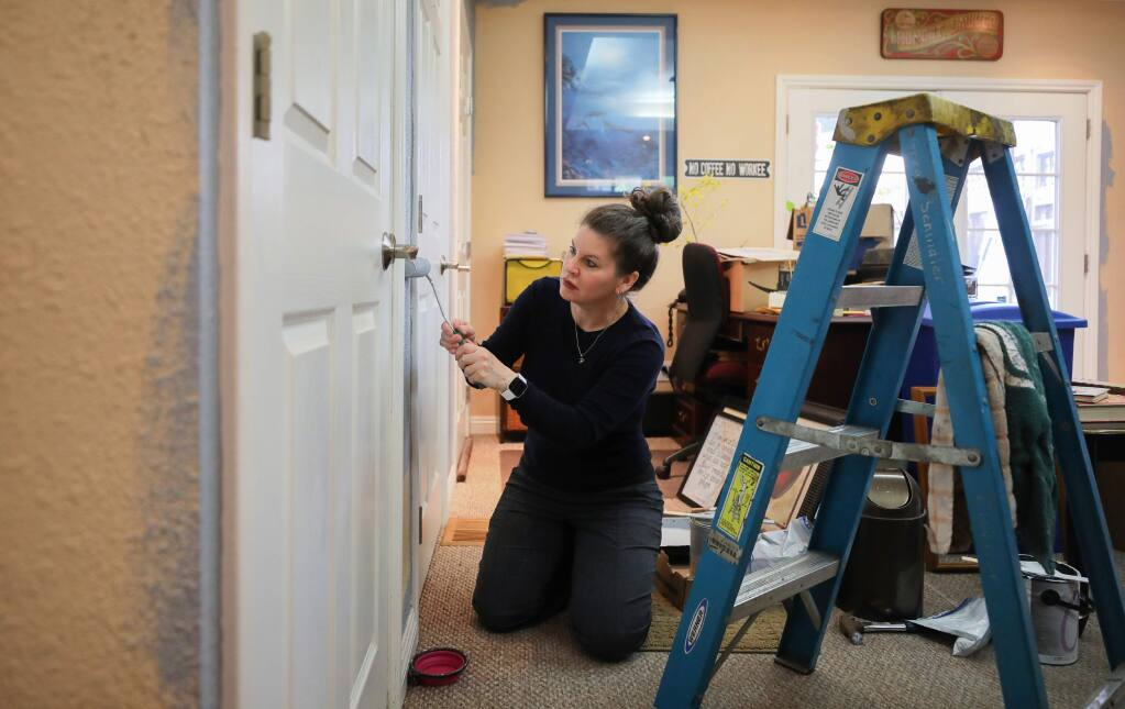 Robin Estes paints the office in her Santa Rosa home on Wednesday, May 13, 2020. Estes has used her time during the shelter in place to make improvements around her house.(Christopher Chung/ The Press Democrat)