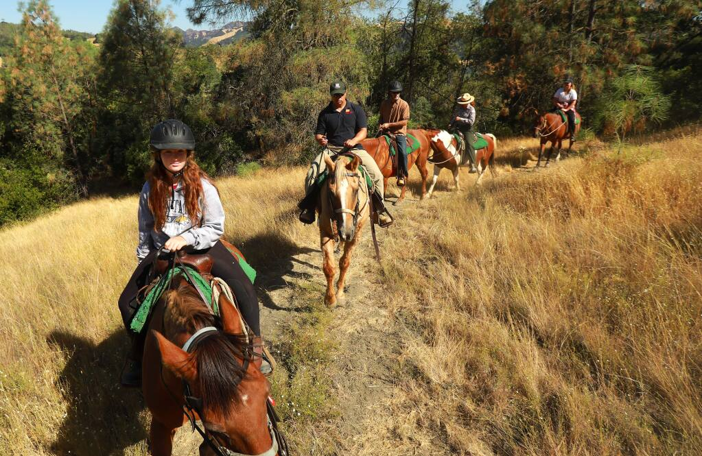 U.S. Army Corps Park Ranger Poppy Lozoff, 4th from the left, leads 'An Interpretive Ride With a Ranger' at Lake Sonoma on Thursday, July 27, 2017. (John Burgess/The Press Democrat)