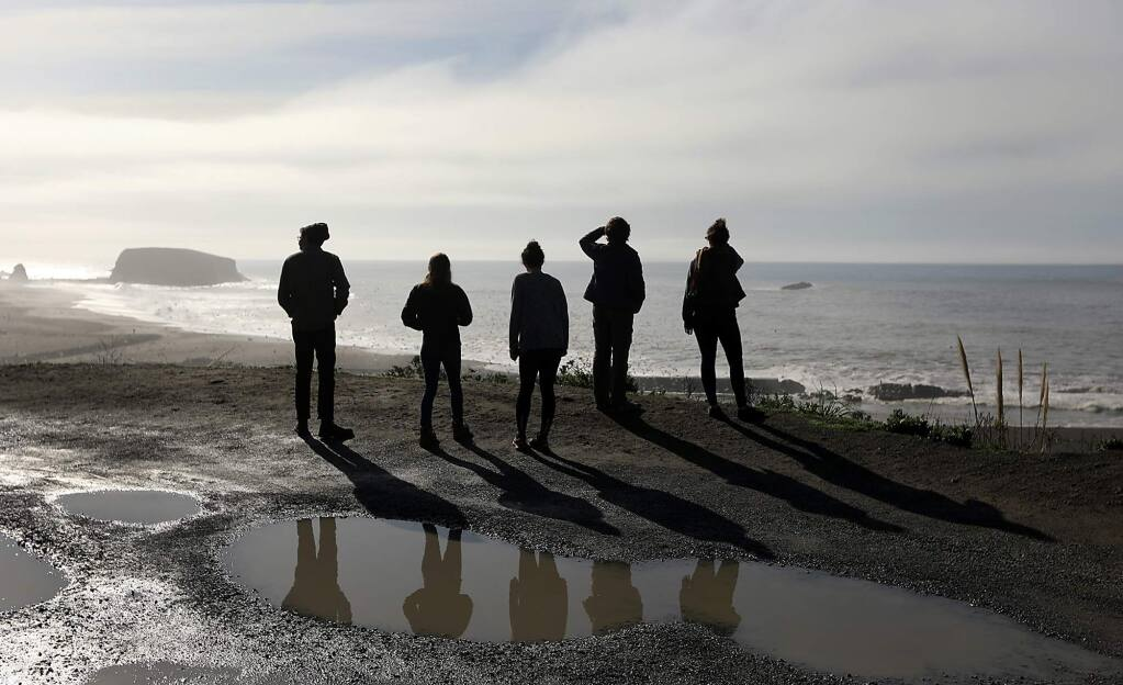 A group of friends and relatives from Sonoma County take in the view of the Pacific Ocean from the Jenner bluffs Friday Jan. 1, 2018. A pristine view as far as the eye can see, the Trump administration has renewed the prospect of offshore oil drilling along the Pacific coast and the reduction of marine sanctuaries. (Kent Porter / The Press Democrat) 2018