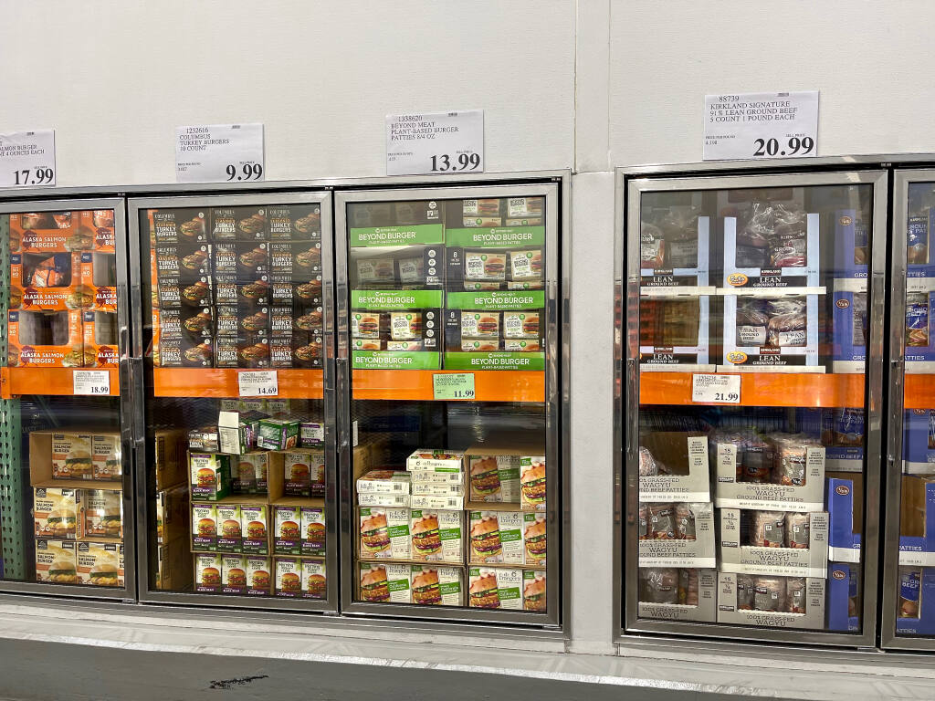 Vegan burgers are sandwiched between fish, turkey and beef burgers in a Costco freezer. (Kathryn Reed Photo)