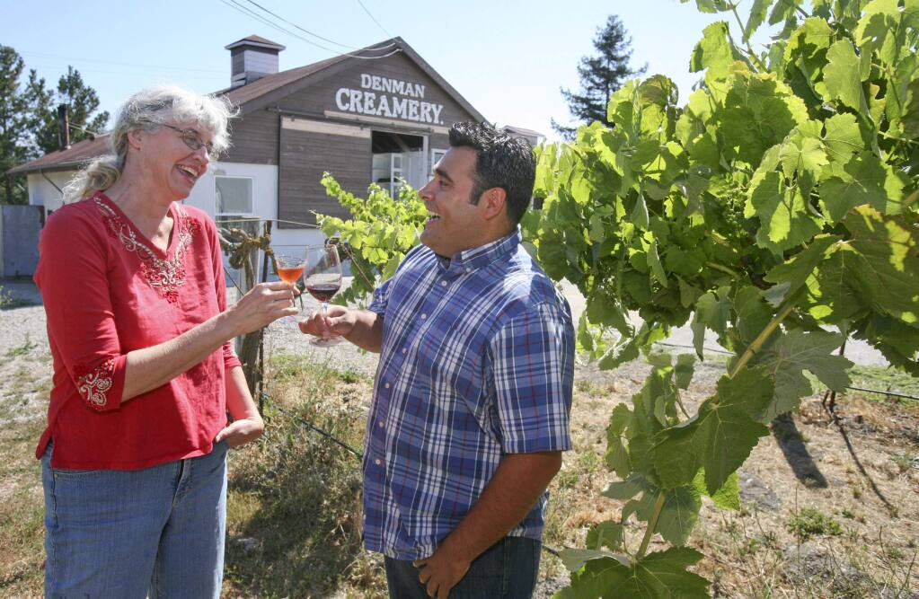 Laura Hagar Rush and P.W. Scoggins toast their new businesses in the vineyard at the historic Denman Creamery in Penngrove, which they share for Hagar Rush's Sonoma Aperitif and Scroggins's winery, on Tuesday, July 1, 2014. (Scott Manchester / Argus-Courier staff)