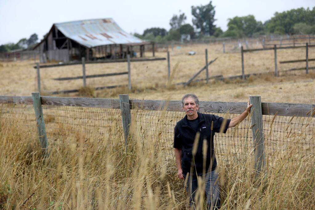 (FILE PHOTO) Walker Avenue resident Greg Eicher stands next to the proposed site of a compost facility, just north of the Laguna Wastewater Treatment Plant on Llano Road. Photo near Santa Rosa on Thursday, Sept. 5, 2019. (BETH SCHLANKER/ PD)