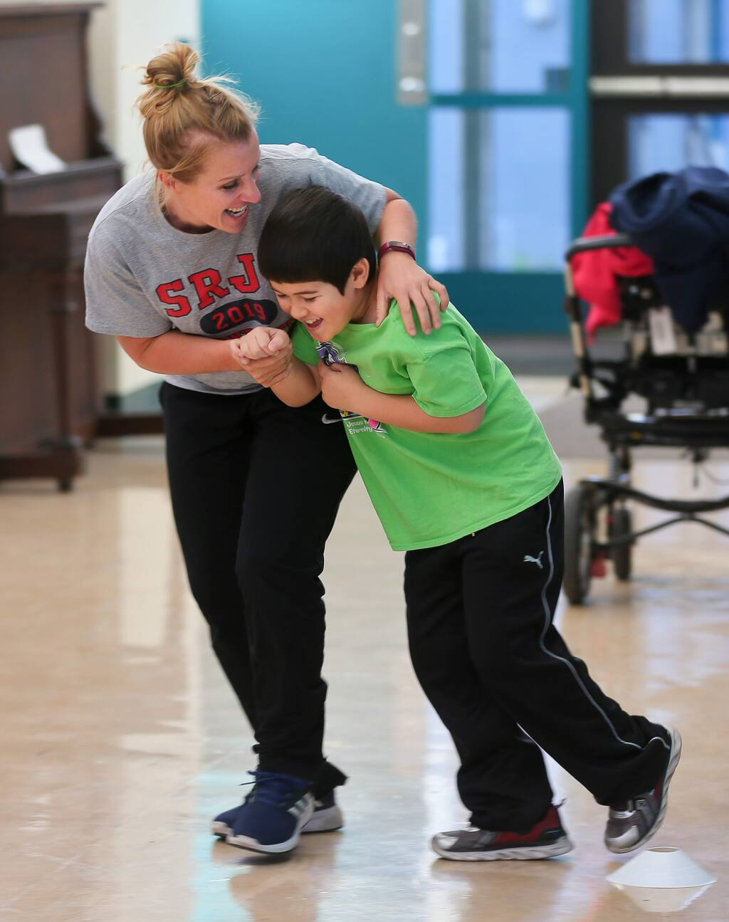 Education specialist Katya Robinson, left, plays with one of her former students, Jaxon Ono, during a physical education class at Park Side Elementary School in Sebastopol on Friday, October 11, 2019. (Christopher Chung/ The Press Democrat)