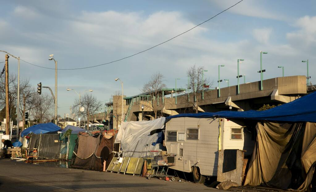 A tent encampment in West Oakland. Photo by Anne Wernikoff for CalMatters