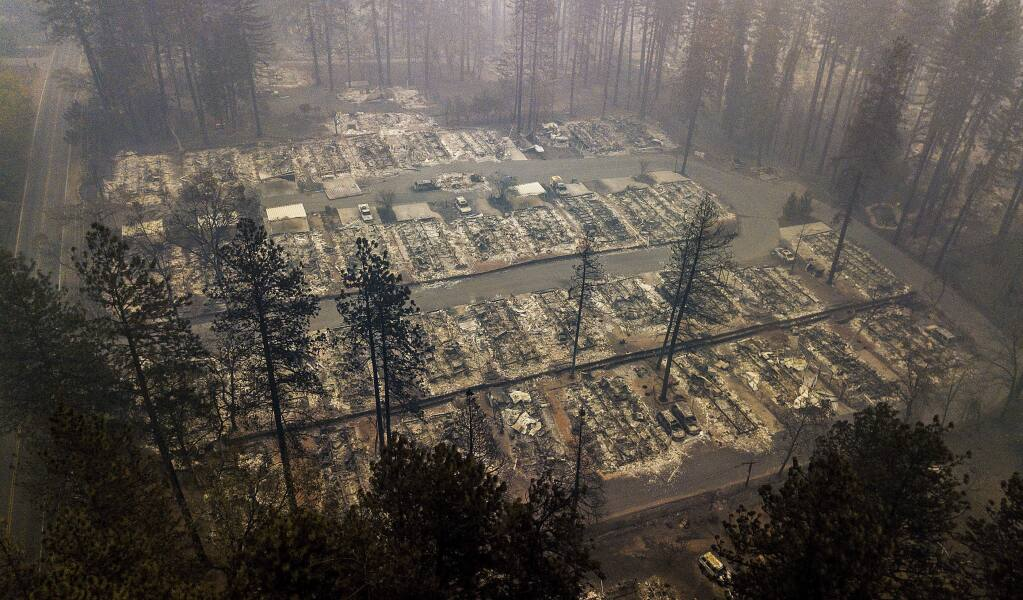 FILE - In this Nov. 15, 2018, file photo, residences leveled by the wildfire line a neighborhood in Paradise, Calif. The massive wildfire that killed dozens of people and destroyed thousands of homes has been fully contained after burning for more than two weeks, authorities said Sunday, Nov. 25. (AP Photo/Noah Berger, File)
