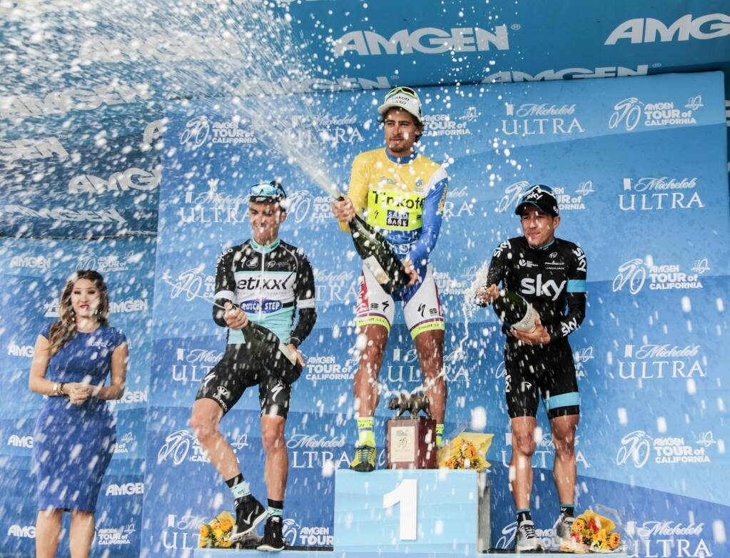 Peter Sagan of Slovakia riding for Tinkoff-Saxo, middle, celebrates his victory of the final overall standings along with second place finisher Julian Alaphillippe of France riding for Etixx-QuickStep, left, and third place finisher Sergio Henao of Columbia riding for Team Sky, right, at the end of the 2015 Amgen Tour of California from Los Angeles to Pasadena at the Rose Bowl on Sunday, May 17, 2015. (AP Photo/Damian Dovarganes)
