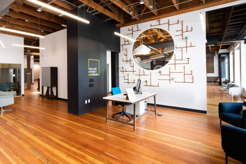 The rich wood flooring and exposed ceiling of this restored 1920s warehouse form the setting for flexible work environments at Keller Street CoWork helping to redefine the future of work. (COURTESY OF BELLI ARCHITECTURAL GROUP) 2018