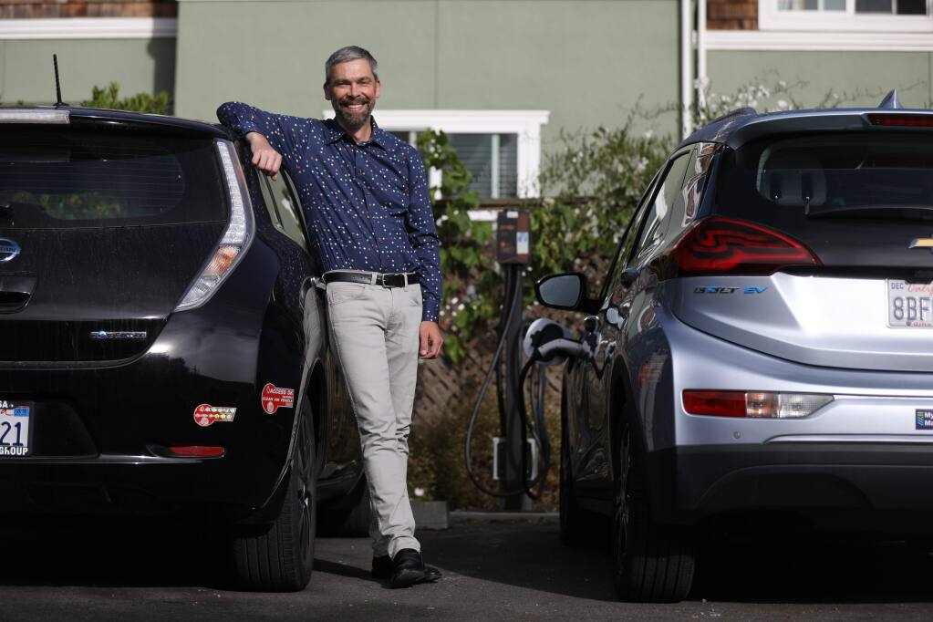 Geof Syphers the CEO of Sonoma Clean Power stands near a charging stations for electric vehicles at Frogsong Cohousing in Cotati, California on Friday, August 2, 2019. (BETH SCHLANKER/The Press Democrat)
