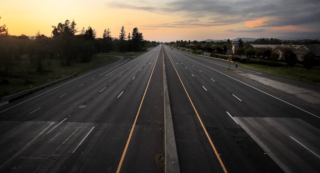 In what would normally be a bust commute, Highway 101 at Shiloh Road in Windsor has little traffic, Thursday, April 16, 2020. (Kent Porter / The Press Democrat) 2020
