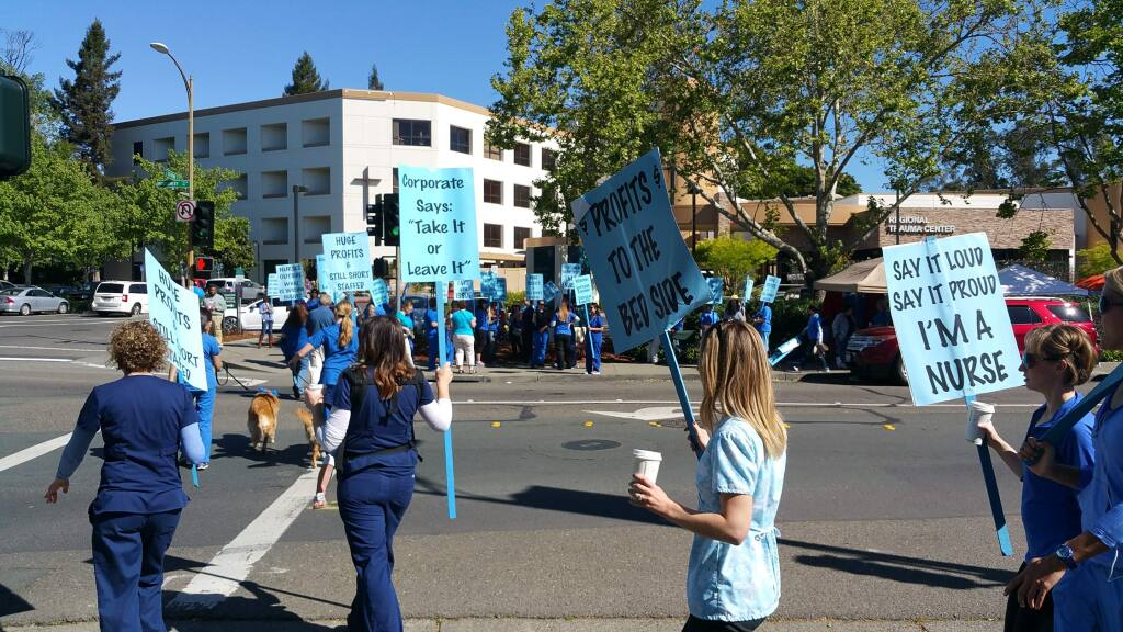 Memorial Hospital nurses on strike in front of Santa Rosa Memorial Hospital, in Santa Rosa on Monday, April 27, 2015. (MARTIN ESPINOZA / PRESS DEMOCRAT)