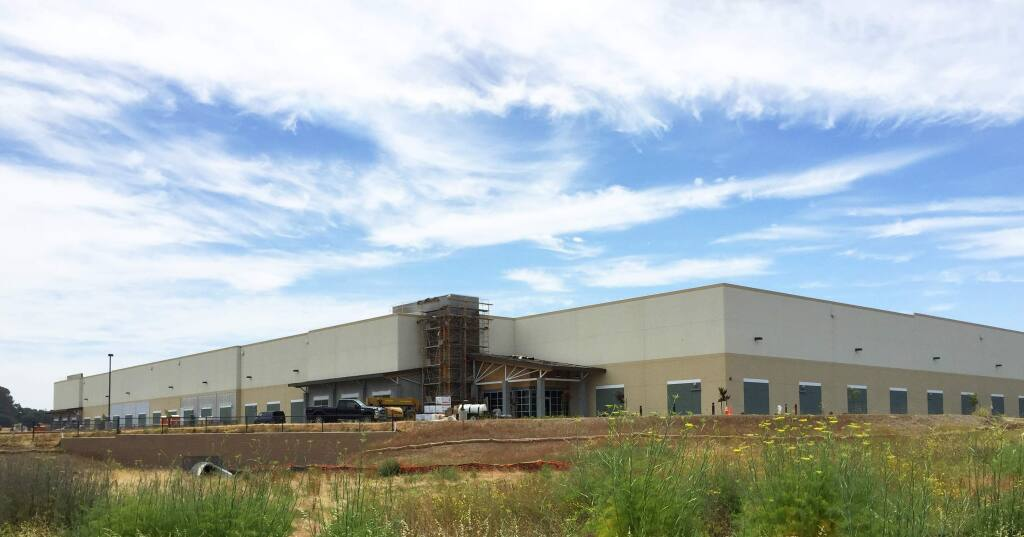 The exterior of the 226,000-square-foot first warehouse in the Greenwood Business Park development in south Napa nears completion June 17, 2015. Windsor-based Pack n' Ship Direct has reserved the entire building for its Napa Valley expansion. (DTZ)