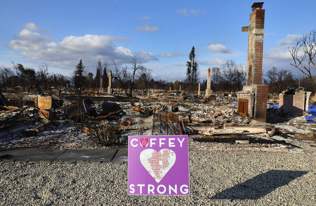 A Coffey Strong sign is posted in front of a burned home along Tuliptree Road, in the Coffey Park area in Santa Rosa on Thursday, November 2, 2017. (Christopher Chung/The Press Democrat)