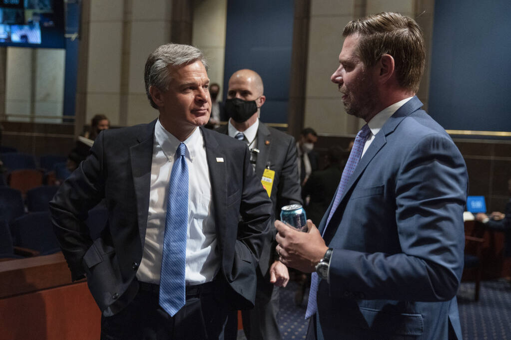 FBI Director Christopher Wray, left, and House Judiciary Committee member Rep. Eric Swalwell, D-Calif., talk during a recess of the committee's oversight hearing on the Federal Bureau of Investigation on Capitol Hill, Thursday, June 10, 2021, in Washington. (AP Photo/Manuel Balce Ceneta)