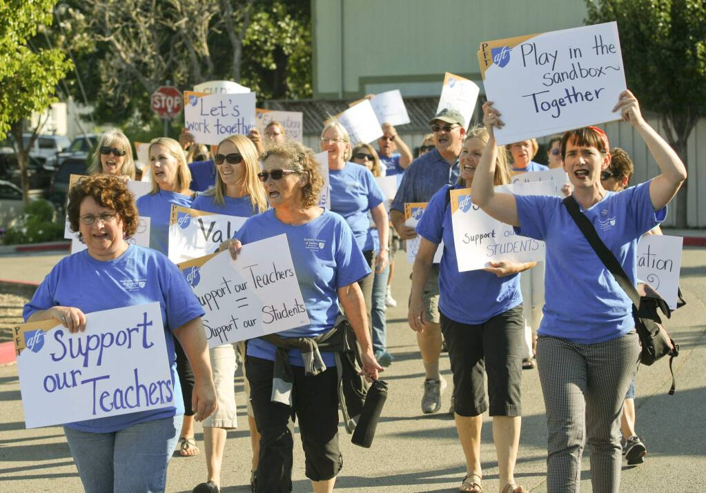 Petaluma City Schools teachers march to the Petaluma City Schools school board meeting in Petaluma on Tuesday night August 19, 2014, to draw attention to the fact that they have no contract and among other things haven't had a cost of living raise in seven years. (SCOTT MANCHESTER/ARGUS-COURIER STAFF)