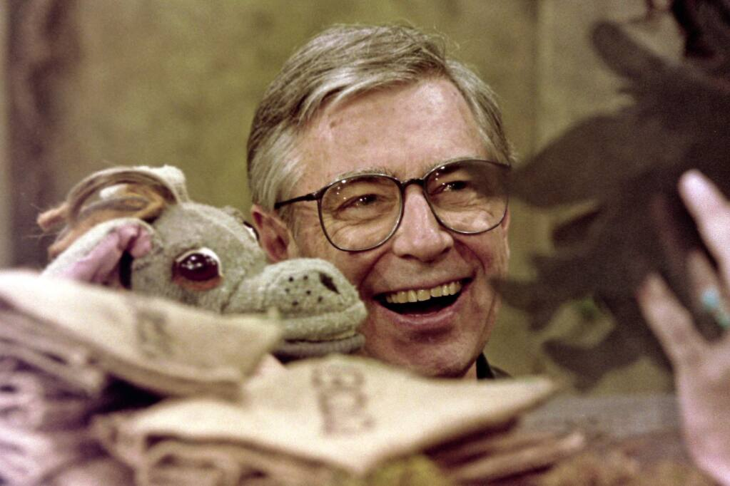 Fred Rogers worksg with Donkey Hodie, one of the puppets featured on his children's television program, 'Mr. Rogers' Neighborhood.' (GENE J. PUSKAR / Associated Press, 1993)