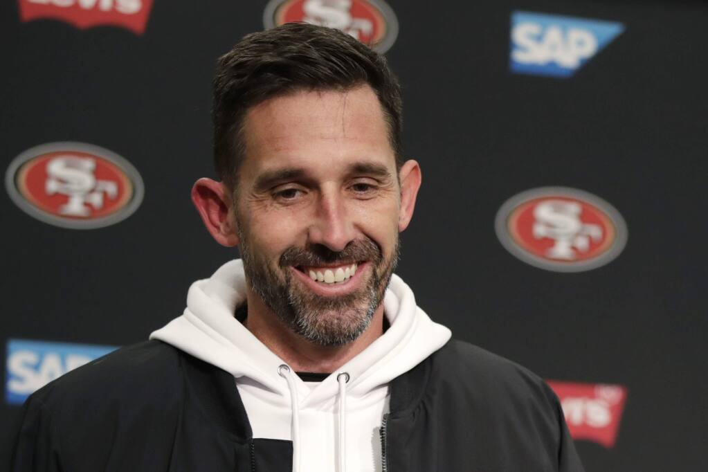 FILE - In this Dec. 29, 2019, file photo, San Francisco 49ers head coach Kyle Shanahan smiles during a news conference after an NFL football game against the Seattle Seahawks in Seattle. The 49ers rewarded Shanahan with a new six-year contract Monday, June 15, 2020, after he took the team to the Super Bowl in his third season at the helm. A person familiar with the deal said the Niners are replacing the three years remaining on Shanahan's original six-year contract signed in 2017 to keep him under contract through 2025. The person spoke on condition of anonymity because the deal hasn't been announced. (AP Photo/Stephen Brashear, File)