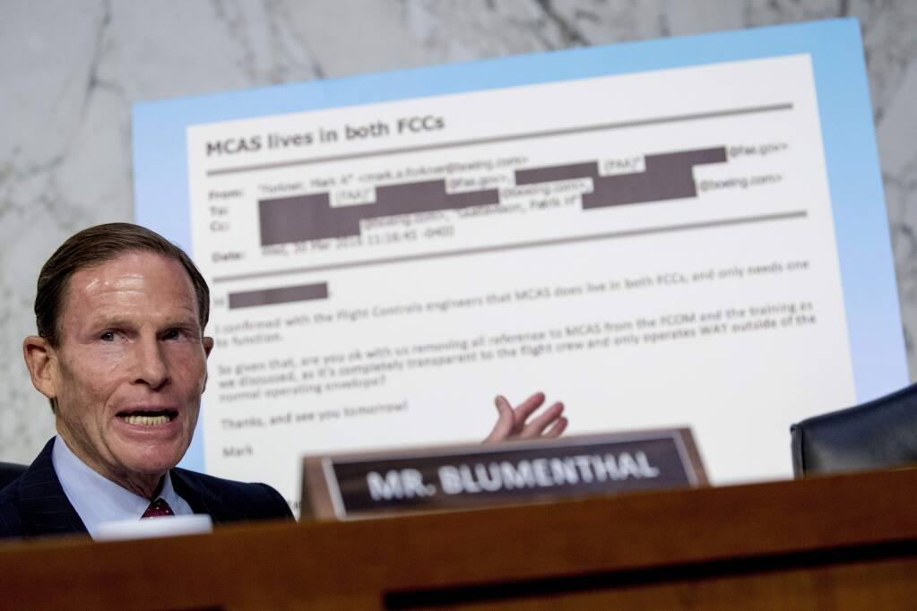 Rep. Richard Blumenthal, D-Conn., displays an email exchange behind him as he questions Boeing Company President and Chief Executive Officer Dennis Muilenburg as he testifies before a Senate Committee on Commerce, Science, and Transportation hearing on 'Aviation Safety and the Future of Boeing's 737 MAX' on Capitol Hill in Washington, Tuesday, Oct. 29, 2019. (AP Photo/Andrew Harnik)