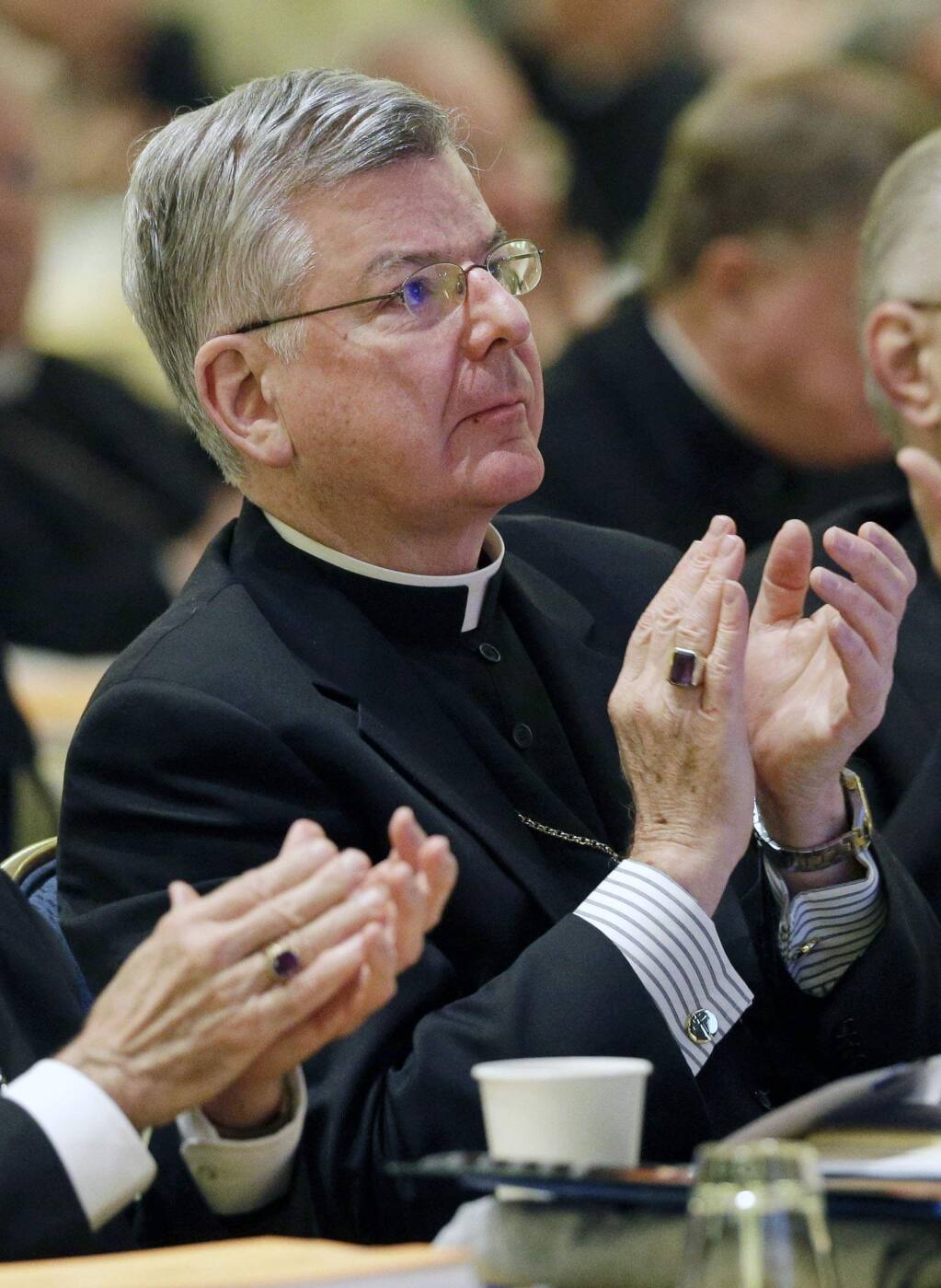 FILE - In this Nov. 12, 2013 file photo, Archbishop John Nienstedt, of St. Paul and Minneapolis, applauds after a presentation at the United States Conference of Catholic Bishops' annual fall meeting in Baltimore. Jennifer Haselberger, the whistleblower who took on the Archdiocese of St. Paul and Minneapolis about allegations of clergy sexual misconduct, said in an affidavit released Tuesday, July 15, 2014, that archbishops and staff ignored the 2002 pledge by Roman Catholic bishops to keep abusive clergy out of parishes. (AP Photo/Patrick Semansky, File)