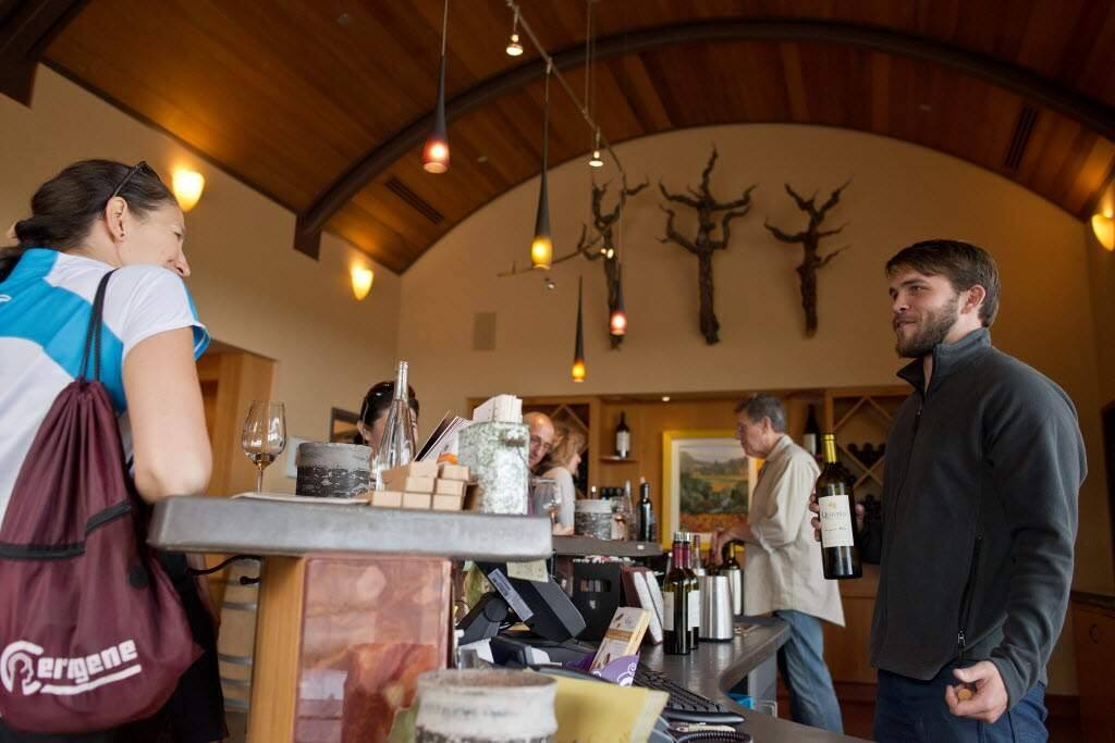 Nick Amtower chats with visitors while pouring Quivira's 2012 Sauvignon Blanc Fig Tree Vineyard at Quivira Vineyards and Winery in Healdsburg. (Alvin Jornada / The Press Democrat)