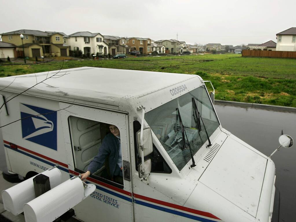 Lisa Emond delivers mail next to a Ryder Homes subdivision in southwest Santa Rosa in this 2009 Press Democrat file photo. (KENT PORTER/THE PRESS DEMOCRAT)