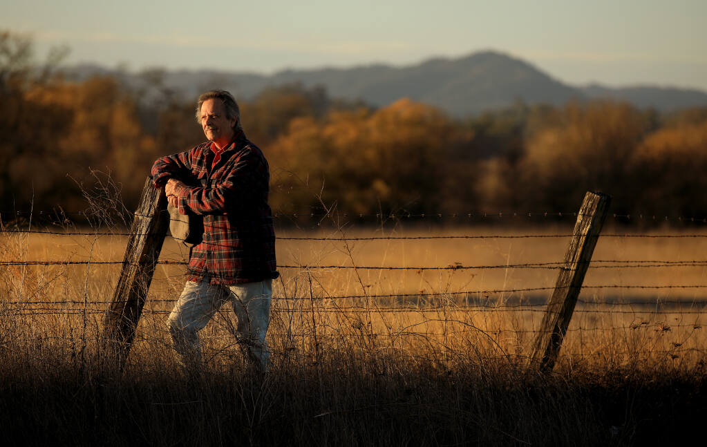 Artist Richard McDaniel stands in one his favorite areas in the Russian River watershed, the Laguna de Santa Rosa, on Thursday, Dec. 8, 2020 (Kent Porter / The Press Democrat)