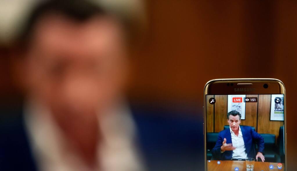 A Press Democrat editorial board meeting with Lt. Gov. Gavin Newsom is streamed on Facebook Live, in Santa Rosa, California on Tuesday, October 11, 2016. (Alvin Jornada / The Press Democrat)