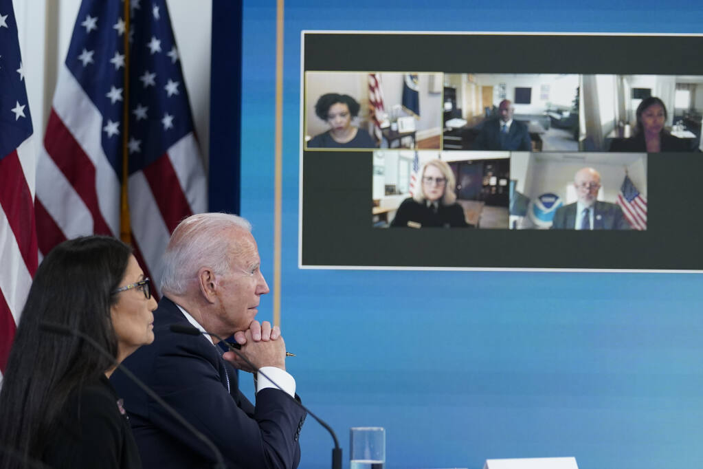President Joe Biden, right, and Interior Secretary Deb Haaland, left, listen during an event in the South Court Auditorium on the White House complex in Washington, Wednesday, June 30, 2021, with cabinet officials and governors from Western states to discuss drought and wildfires. (AP Photo / Susan Walsh)