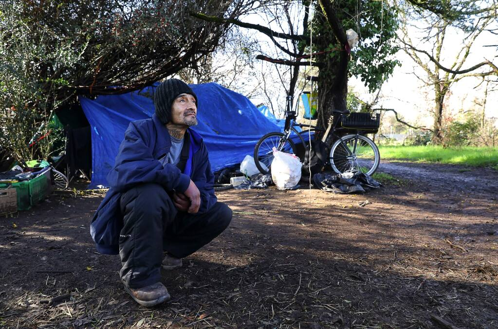 Manuel Santiago has been living in an area of southwest Santa Rosa since Camp Michela, a homeless camp in the Roseland area, was shut down.(Christopher Chung/ The Press Democrat)