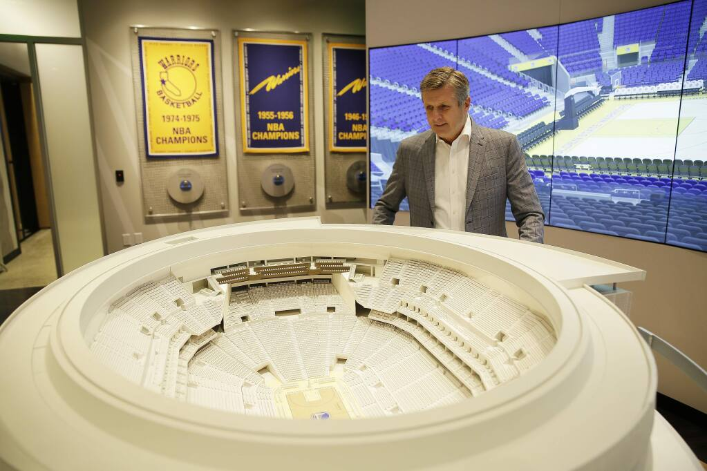 In this Jan. 24, 2018, file photo, Golden State Warriors president and COO Rick Welts looks over a model of Chase Center at the Chase Center Experience in San Francisco. (AP Photo/Eric Risberg, File)