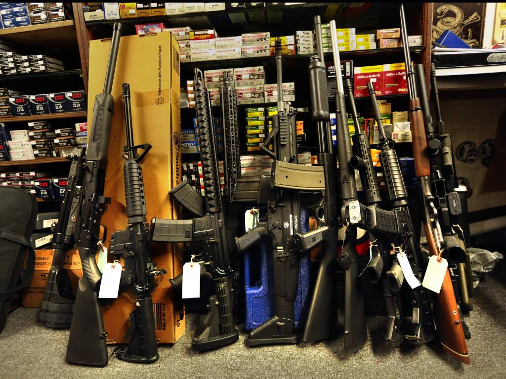 Owner Gabriel Vaughn sold 13 semi-automatic and bolt action rifles before noon on Wednesday at the Sportmans Ams in Petaluma. (JOHN BURGESS / The Press Democrat)