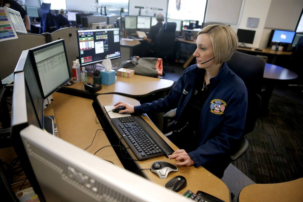 KT McNulty, a supervising dispatcher, oversees a call during a training session at the REDCOM dispatch office on Wednesday, Feb. 14, 2018 in Santa Rosa. (BETH SCHLANKER/The Press Democrat)